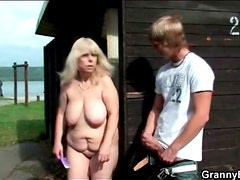 Fat old slut sucks his young dick in public