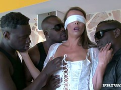 Blindfolded Brunette Caroline Tosca Surprised with Three Big Black Cocks