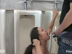 Annie Cruz gets pissed in her mouth in the men's room