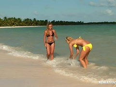Angelina Love and Kathy Campbel explore each other's cunts on a beach