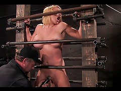 Stunning blonde having her pussy toyed in device bondage