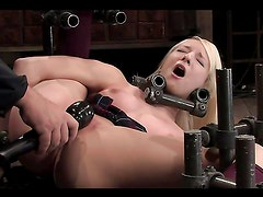 Vibrator toying for blonde Ashley Jane in bondage session.