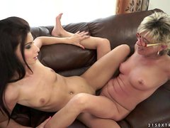 Granny and a sexy brunette are rolling in lesbian