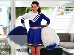 Stunning Gigi Marie poses in sexy cheerleader uniform