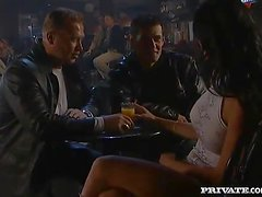 Double penetration with a filthy brunette in the smoky bar
