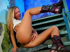 Blonde bombshell Cindy pokes her tight pink pussy with smooth sex toy