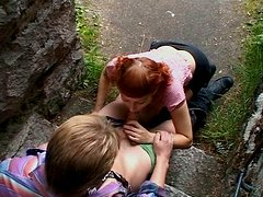 Filthy amateur redhead chick has dirty oral sex outdoor