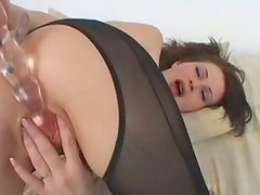 Hussy chick Electra in sexy black pantyhose fucks her slit with dildo