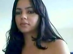 Amateur beauty with natural boobies is posing