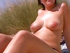 Pumping her sweet pussy on the beach