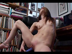 A hot solo scene with Sensi Pearl sitting on an office chair