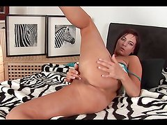 Brunette hottie sticks hard toy in her pussy