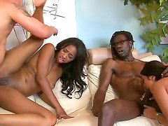 A hot babe takes a enormous black cock up her pussy -- even her ass hole -- and