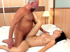 Bald headed fart enjoys young body and pussy of brunette babe