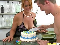 Busty mom Joss licks cream off a prick and gets fucked