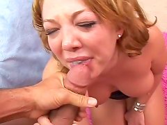 Smiling redhead receives sperm shot in her mouth