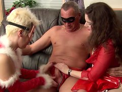 Brunette and blonde blow old man's cock together