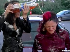Fully clothed babes get messy at carwash