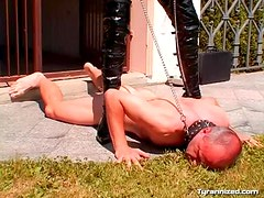 Collared man plays pet to her outdoors