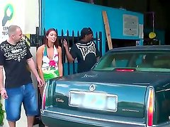 Adorable slim chick meets up with wild raunchy dudes at an auto repair shop. She