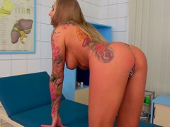 Busty tattooed blonde is fingering her pussy and sucking dick