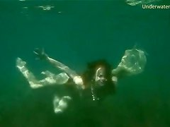 Young lady goes skinny dipping in the ocean