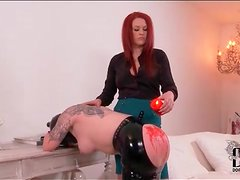 Hot wax drips on big ass of submissive girl