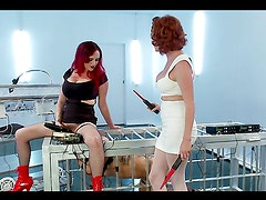 Electro slut trapped in cage by domme