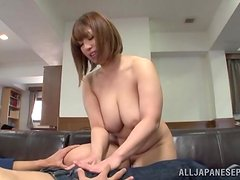 Busty Japanese skank sucks a cock before taking it in her snatch