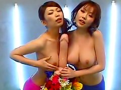 Asians shemales are posing topless with dildo