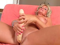 Horny blonde granny is getting her twat poked with big dildo