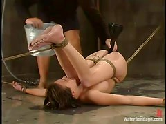 Audrey Leigh enjoys a stream of water on her snatch in BDSM scene