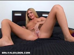 Blonde Larin has a deep throat and wet pussy that swallows big dildos