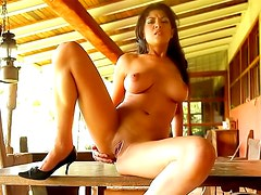 Naked Latina rubs her pussy on the table
