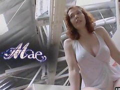 Big breast redhead plays with her pussy