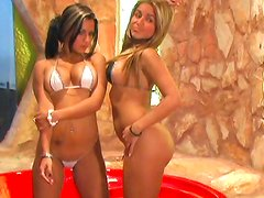 Tanned twins show their fake tits in the jacuzzi