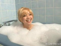 Blonde Japanese girl takes a bath and sucks a dick