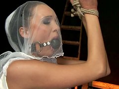 Gagged and tied up brunette bride gets her pussy fingered tough by spoiled man