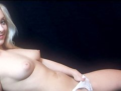 Amazing pale blondie Lianna poses and shows her perfect natural tits on cam