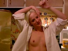 Whorish girlfriend flashes her small tits in the kitchen
