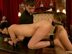 Tied up Cherry gets toyed with a strap on by Sarah