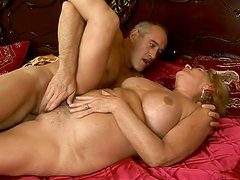 Huge fat lewd oldie gets busy with riding a strong dick on the wide bed