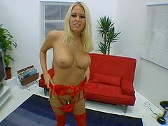 Luscious blond MILF strips in front of cam boasting with huge tits