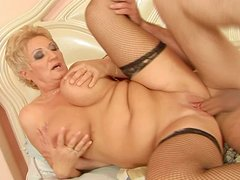 Mature trollop in black stockings rides the dick like mad