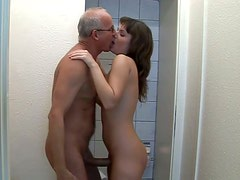 Insatiable brunette whore gives head in public toilet