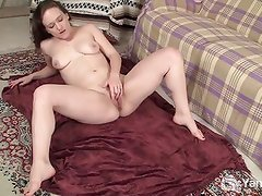 Flexible babe fingering her shaved pussy