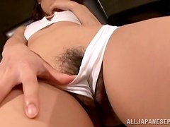Naughty Japanese girl is touching her bushy beaver