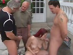 Trashy red haired bitch is piss drinking in dirty gangbang session