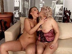 Mature lesbian granny in a hot lesbo fuck clip featuring young brunette chick