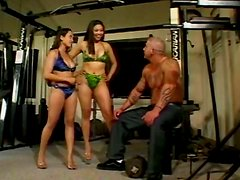 Two voracious Asian prostitutes give head to beefy coach in gym